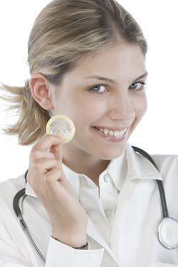 Female Doctor holding condoms
